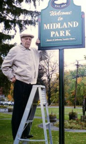 Johnny Vander Meer with sign on park that bears his name