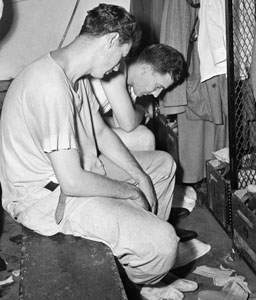 Ted Williams and Mickey Harris dejected.