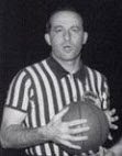 Referee Norm Drucker