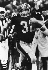 Franco Harris running with the Immaculate Reception