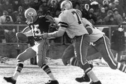 Starr being sacked by Cowboys.