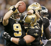 Saints QB Drew Brees celebrates victory.