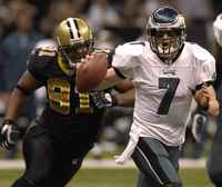 Philadelphia QB Jeff Garcia runs out of the pocket.