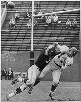 John Baker smashes Y.A. Tittle.